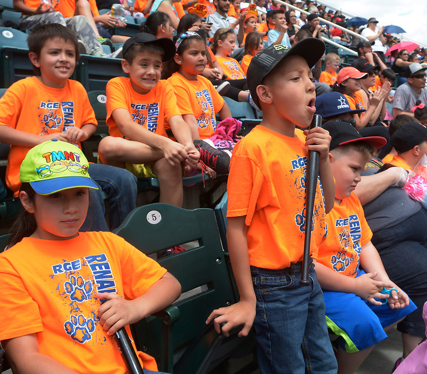 gbs050917a/SPORTS -- Los Lunas Elementary first grader Jeriko Olguin, 7, center, cheers the Isotopes as he watches the game with classmates, including Leiah Garibay, 7, left, and Jordayn Galaz, 7, right at Isotopes Park on Tuesday, May 9, 2017. (Greg Sorber/Albuquerque Journal)