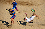 CATANIA, ITALY - AUGUST 16: Erol Kigaste of Estonia attempts a scissor kick shot on goal in front Nicolae Ignat of Moldavia during the Euro Beach Soccer League match between Moldova and Estonia on August 16, 2019 in Catania, Italy. (Photo by Quality Sport Images