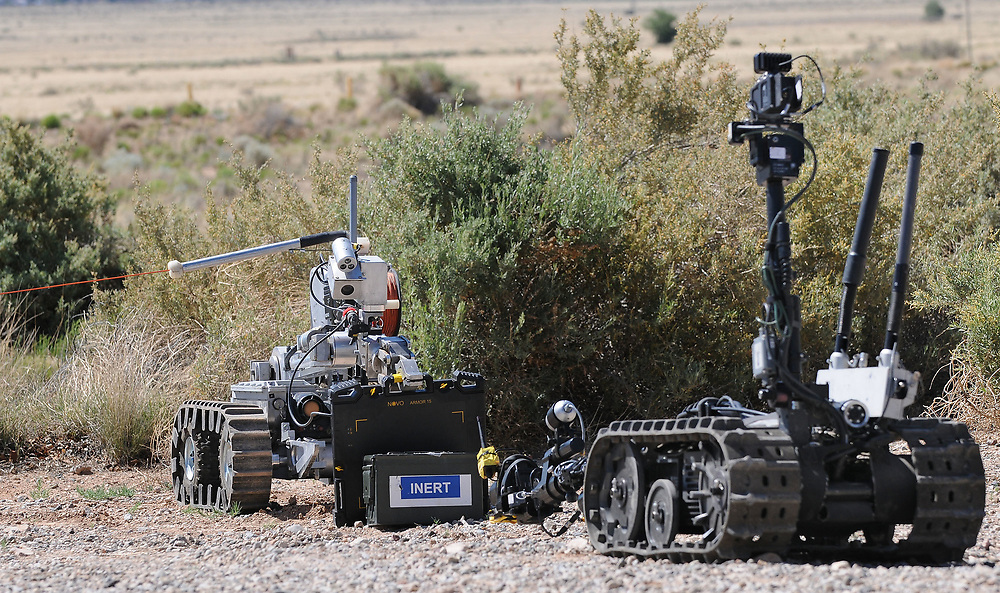 jt052317h/ a sec/jim thompson/A robot in backand the one in front prepare to x-ray a suspicious package in the senecio for the Western National Robot Redeo held at Sandia National Labs. Tuesday May. 23, 2017. (Jim Thompson/Albuquerque Journal)
