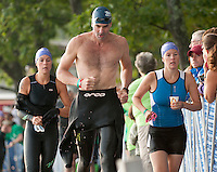Pat McGonagle of Gilford coming out of the water heading into the bike transition area during the Timberman Sprint competition on August 20, 2011.  (Karen Bobotas/for the Laconia Daily Sun)