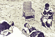 Three women and an empty chair on the beach in New Jersey (mid-1980's)