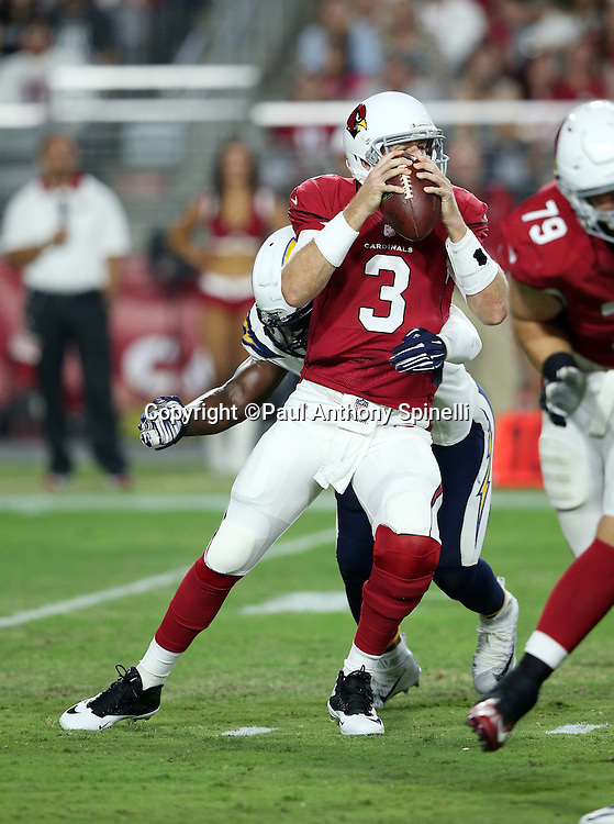 Arizona Cardinals quarterback Carson Palmer (3) gets sacked by San Diego Chargers inside linebacker Donald Butler (56) on a first quarter pass attempt during the 2015 NFL preseason football game against the San Diego Chargers on Saturday, Aug. 22, 2015 in Glendale, Ariz. The Chargers won the game 22-19. (©Paul Anthony Spinelli)