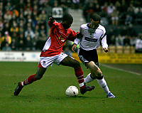 Ryan Smith of Derby County (white) attacks down the wing