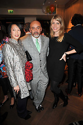 Left to right, ROSEY CHAN, Christian Louboutin and MEREDITH OSTROM at the launch party of 'Songs For Sorrow' hosted by Alber Elbaz and Mika held at Lanvin, 32 Savile Row, London on 11th November 2009.
