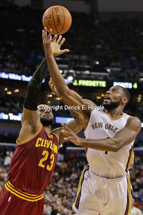 Dec 12, 2014; New Orleans, LA, USA; New Orleans Pelicans forward Tyreke Evans (1) shoots over Cleveland Cavaliers forward LeBron James (23) during the second quarter of a game at the Smoothie King Center. Mandatory Credit: Derick E. Hingle-USA TODAY Sports