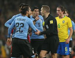 Uruguay's Luis Suarez (centre left) confronts referee Craig Pawson after awarding Brazil a penalty