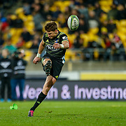 Beauden Barrett kicks during the Super rugby union game (Round 14) played between Hurricanes v Reds, on 18 May 2018, at Westpac Stadium, Wellington, New  Zealand.    Hurricanes won 38-34.