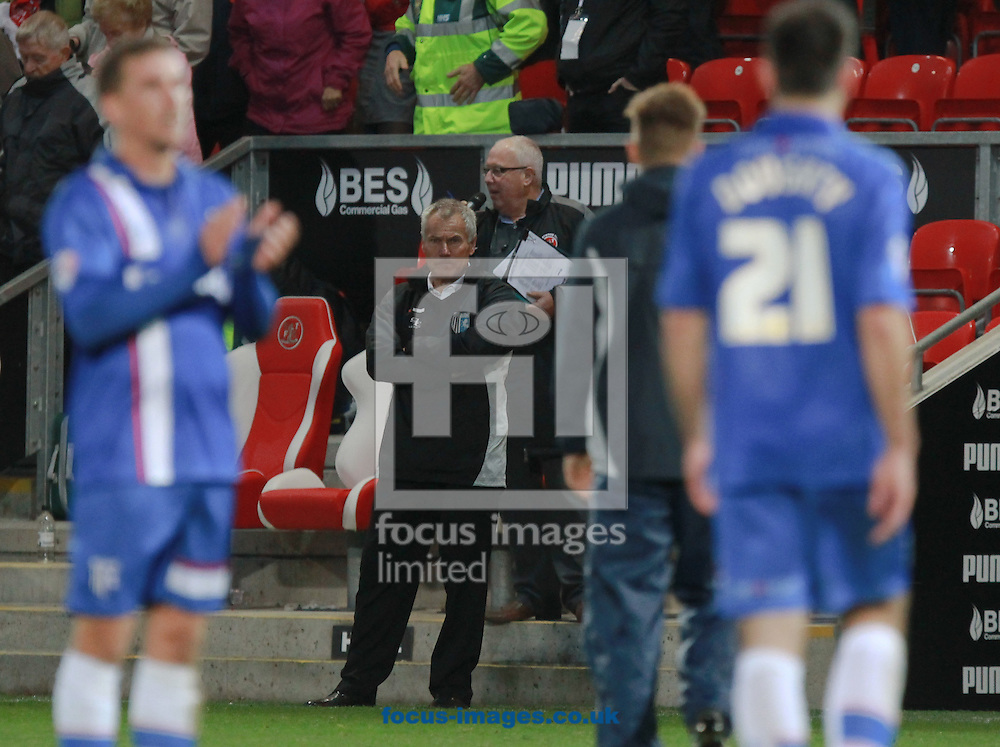 Peter Taylor, manager of Gillingham looks on as his players thank their supporters after the Sky Bet League 1 match at the Highbury Stadium, Fleetwood<br /> Picture by John Rainford/Focus Images Ltd +44 7506 538356<br /> 01/11/2014