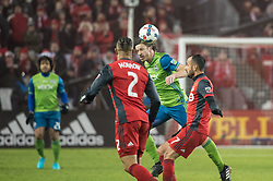 December 9, 2017 - Toronto, Ontario, Canada - Seattle Sounders defender GUSTAV SVENSSON (4) heads the ball in between Toronto FC defender JUSTIN MORROW (2) and Toronto FC midfielder VICTOR VAZQUEZ (7) during the MLS Cup championship match at BMO Field in Toronto, Canada.  Toronto FC defeats Seattle Sounders 2 to 0. (Credit Image: © Mark Smith via ZUMA Wire)