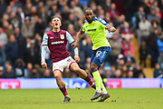 Aston Villa midfielder Jack Grealish (10) reacts to a tackle by Derby County forward Cameron Jerome (32) during the EFL Sky Bet Championship match between Aston Villa and Derby County at Villa Park, Birmingham, England on 28 April 2018. Picture by Jon Hobley.