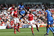 AFC Wimbledon defender Adedeji Oshilaja (4) heads for goal during the EFL Sky Bet League 1 match between Fleetwood Town and AFC Wimbledon at the Highbury Stadium, Fleetwood, England on 4 August 2018. Picture by Craig Galloway.