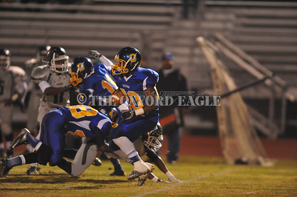 Oxford High's D.K. Hutchins (20) vs. Vicksburg in MHSAA Class 5A playoff action in Oxford, Miss. on Friday, November 15, 2013. Oxford won 50-7.