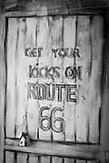 A sign painted on a door along Route 66. Missoula Photographer
