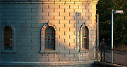 Warm to cool; sun's last rays on the curved wall of Gatehouse 5, Mount Tabor Park, Portland, Oregon, USA.