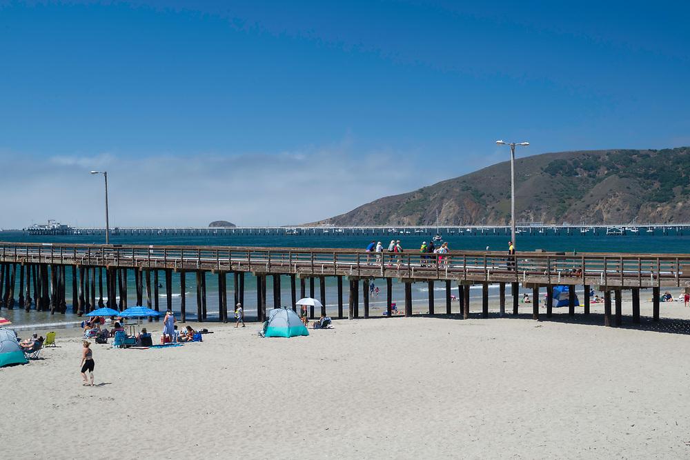 Morning at Avila Beach, California, USA. People arriving to swim, relax, sunbathe.