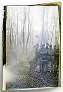 eroding image with soldiers in the woods