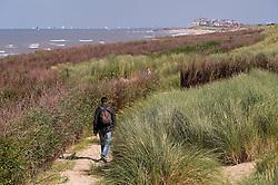 Walking in the sand dunes in De Haan, Belgium, Sunday, Sept. 14, 2008. (Photo © Jock Fistick)