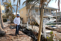 September 13, 2017 - Duck Key, Florida, U.S. - BOB BARNES stayed in Duck Key huddled in a house with 10 other people. He looks over the damage at a friend's home. (Credit Image: © Mike Stocker/Sun-Sentinel via ZUMA Wire)