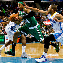 Mar 20, 2013; New Orleans, LA, USA; Boston Celtics small forward Paul Pierce (34) drives past New Orleans Hornets shooting guard Eric Gordon (10) during the second half of a game at the New Orleans Arena. The Hornets defeated the Celtics 87-86. Mandatory Credit: Derick E. Hingle-USA TODAY Sports