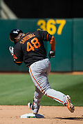 San Francisco Giants third baseman Pablo Sandoval (48) hits a solo home run against the Oakland Athletics at Oakland Coliseum in Oakland, California, on March 25, 2018. (Stan Olszewski/Special to S.F. Examiner)