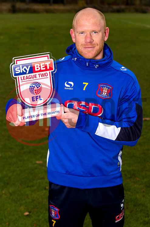 Jason Kennedy of Carlisle United poses for a picture with the Sky Bet League Two Player of the Month Award for October - Photo mandatory by-line: Robbie Stephenson/JMP - 08/11/2016 - FOOTBALL - Creighton Rugby Club - Carlisle, England - Sky Bet League Two Monthly Awards - October