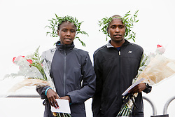 winners Masai and Muge on sward stand at 11th annual Beach to Beacon 10K road race