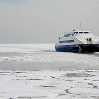 The New York Waterway Fast Ferry 'Finest' navigates through a iced over Raritan Bay to it's home port of Belford NJ.   A extended period of sub freezing temperatures iced over much of New York Harbor creating issues for commuter ferries and commercial marine traffic.