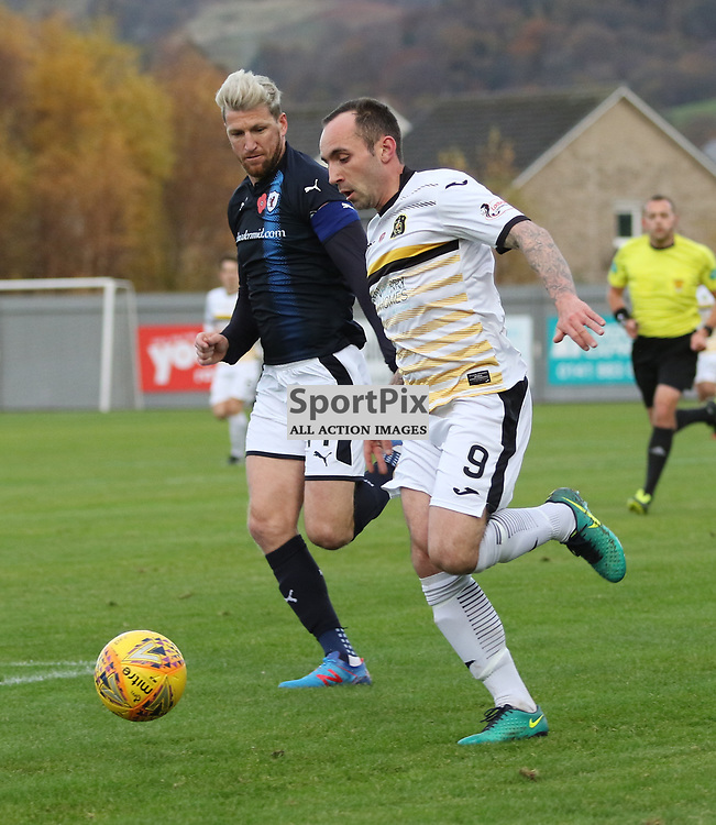 Mark Stewart takes on Iain Davidson during the Dumbarton v Raith Rovers Irn Bru Cup quarter-final 11 November 2017<br />  <br /> <br /> <br /> <br /> <br /> (c) Andy Scott | SportPix.org.uk