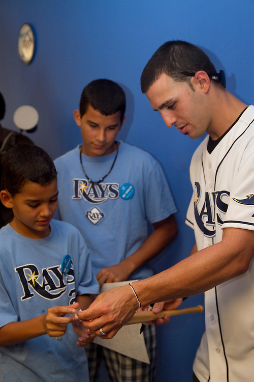 ADayWithTheRaysBoys&GirlsClub..Caption:(Friday 08/13/2010 Pinellas Park)Tampa Bay Rays secondbaseman Sean Rodriguez signs a souvenir bat for Ashael Gonzalez, 11, as his brother Abisai Gonzalez, 14, waits his turn during the Boys & Girls Clubs of The Suncoast event A Day With The Rays, held at the Boys & Girls Club of Pinellas Park...Summary:Boys & Girls Clubs of The Suncoast event A Day With The Rays..Photo by James Branaman