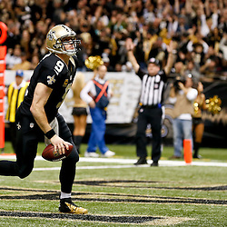 Dec 29, 2013; New Orleans, LA, USA; New Orleans Saints quarterback Drew Brees (9) celebrates after a score against the Tampa Bay Buccaneers during the second half of a game at the Mercedes-Benz Superdome.The Saints defeated the Buccaneers 42-17. Mandatory Credit: Derick E. Hingle-USA TODAY Sports