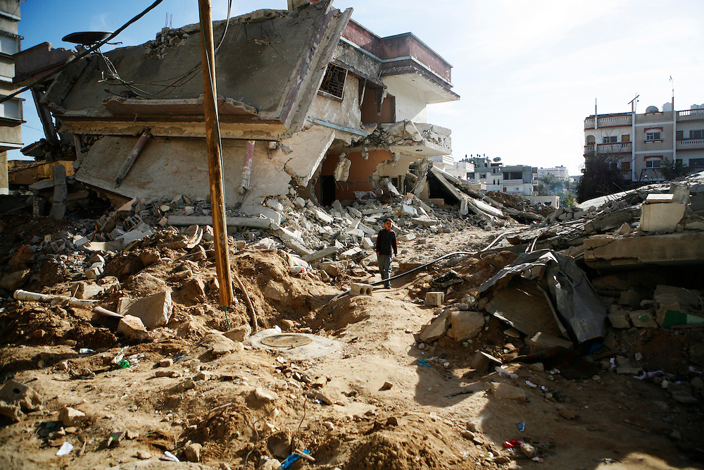 A boy walks through the rubble of a destroyed home in the Ezbat Abed Rabu neighborhood of Jabaliya in the Gaza Strip.