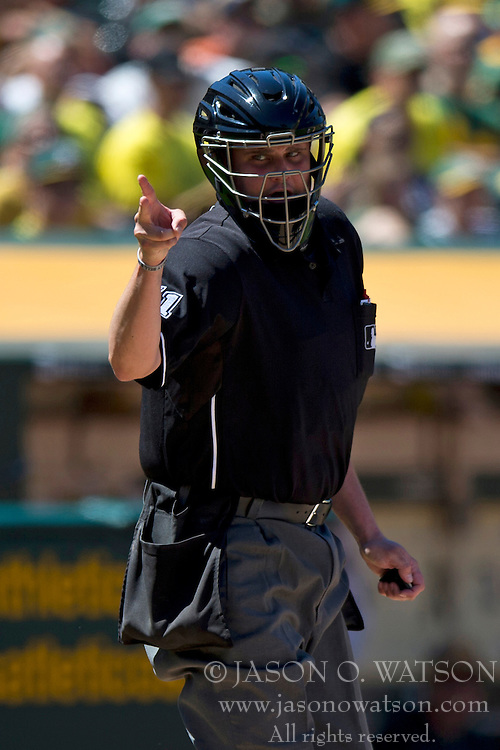 OAKLAND, CA - MAY 26:  MLB umpire Jordan Baker #71 calls a strike against Victor Martinez #41 of the Detroit Tigers (not pictured) during the sixth inning against the Oakland Athletics at O.co Coliseum on May 26, 2014 in Oakland, California. The Oakland Athletics defeated the Detroit Tigers 10-0.  (Photo by Jason O. Watson/Getty Images) *** Local Caption *** Jordan Baker
