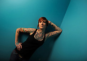 Easthampton, MA 123008  Tattoo artist Eva Huber (Cq), who calls herself an art collector, is one of several female tattoo artists we are featuring. She was photographed at the Off The Map Tattoo shop in Easthampton on December 30, 2008.  (She was working on Ashley Yamilkoski (cq) as her sister Lauren Yamilkoski (Cq) was watching. They are from Covington, MA. And this was Ashley's first tattoo ever and she and her sister opted for a design made of  the initials of the three Yamilkoski siblings.) (Essdras M Suarez/ Globe Staff)/ G
