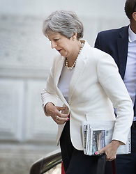 © Licensed to London News Pictures. 25/06/2018. London, UK. Prime Minister Theresa May arrives at the back entrance to Downing Street. Photo credit: Peter Macdiarmid/LNP