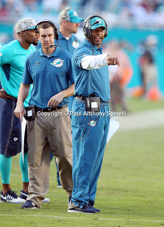 Miami Dolphins assistant defensive backs coach Jeff Burris points as he points and calls out from the sideline during the 2015 week 11 regular season NFL football game against the Dallas Cowboys on Sunday, Nov. 22, 2015 in Miami Gardens, Fla. The Cowboys won the game 24-14. (©Paul Anthony Spinelli)