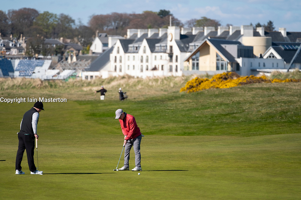 Golfers putting on 2nd Green  at Carnoustie Golf Links in Carnoustie, Angus, Scotland, UK. Carnoustie is venue for the 147th Open Championship in 2018.