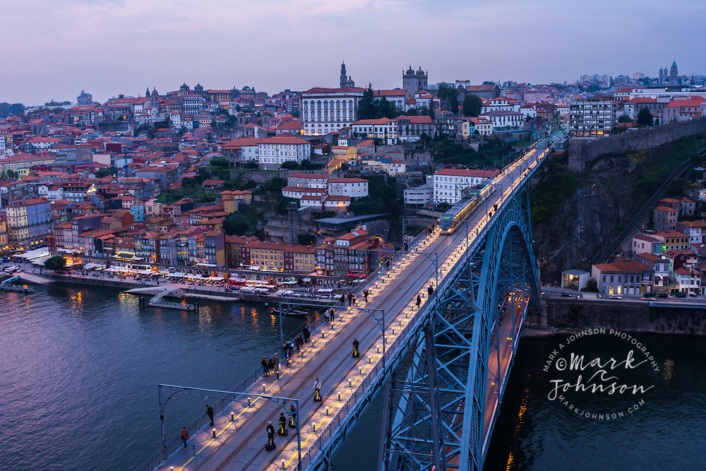 Train crossing the Dom Luis I Bridge over the Douro River, Porto, Portugal
