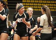 Lone Peak senior Kizzy Willey (10) tries to rally her teammates during the Utah State High School Volleyball 5A championship match between Pleasant Grove and Lone Peak in the UCCU in Orem, Saturday, Nov. 3, 2012.