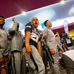 Utah State football player Kennedy Williams (26, middle) reacts to a spare by teammate David Moala (right, 51) during the Famous Idaho Potato BOWL for Charity Presented by Albertsons held at Pinz in the Whooz Family Fun Center in Boise, Idaho. Utah State defeated Akron 201-186. Friday December 18, 2015