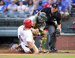 May 12, 2017 - Arlington, TX, USA - Texas Rangers second baseman Rougned Odor (12) slides home as Oakland Athletics catcher Stephen Vogt (21) waits with the ball to make the tag in the second inning on Friday, May 12, 2017 at Globe Life Park in Arlington, Texas. (Credit Image: © Richard W. Rodriguez/TNS via ZUMA Wire)