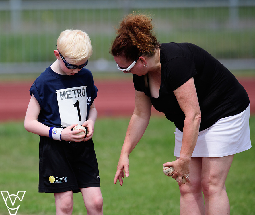 Metro Blind Sport's 2017 Athletics Open held at Mile End Stadium.  Ball throw.  Harry Hughes with volunteer <br /> <br /> Picture: Chris Vaughan Photography for Metro Blind Sport<br /> Date: June 17, 2017