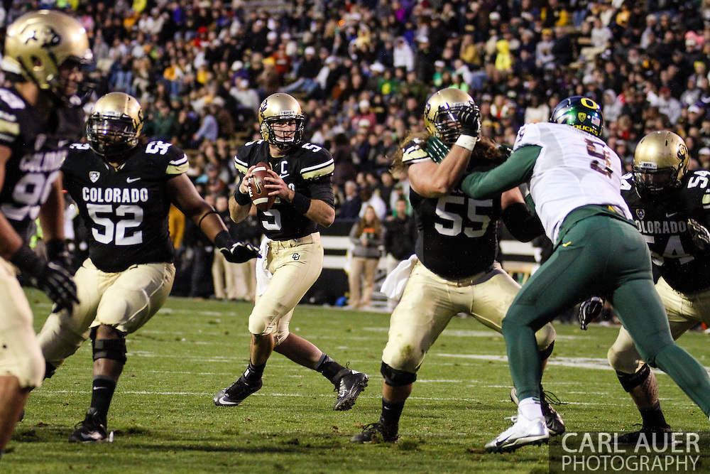 October 5th, 2013:  Colorado Buffaloes junior quarterback Connor Wood (5) looks for a pass in the third quarter of the NCAA football game between the University of Oregon Ducks and the Colorado Buffaloes at Folsom Field in Boulder, Colorado