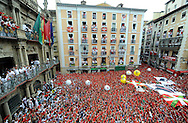 Participants celebrate during the 'Chupinazo' to mark the start of the San Fermin Festival on July 6, 2014 in front of the Town Hall of Pamplona, northern Spain. Tens of thousands of people packed Pamplona's streets for a drunken kick-off to Spain's best-known fiesta: the nine-day San Fermin bull-running festival. PHOTO/ RAFA RIVAS