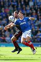 Football - 2016 / 2017  League Two - Portsmouth vs.Doncaster Rovers<br /> <br /> Matty Blair of Doncaster Rovers and Kal Naismith of Portsmouth go shoulder to shoulder in an attempt to win the ball at Fratton Park<br /> <br /> Colorsport/Shaun Boggust