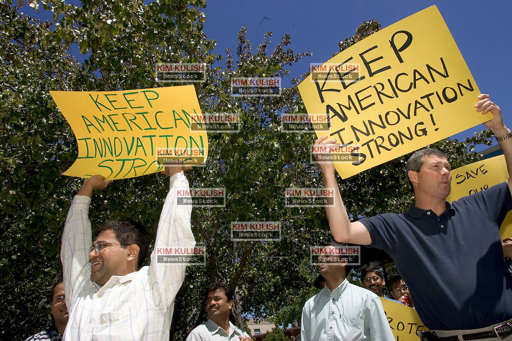 Palo Alto, CALIF. June 24, 2004-Sanjay Noronha, L, and Martin Silver protest in opposition to stock option regulations outside Palo Alto City Hall, June 24, 2004 Photo by Kim Kulish