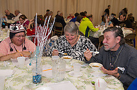 Ann Palazzo, Joanne Fuller and David Fuller enjoy a bowl of pea soup as their first course during the Hands Across the Table dinner at St Andre Bassette Parish Hall Wednesday evening.  (Karen Bobotas/for the Laconia Daily Sun)
