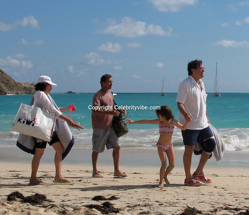 **EXCLUSIVE**.Peter Brant, Stephanie Seymour's husband with daughter, Lilly Margaret on the beach..St Barth, Caribbean..Monday, December 28, 2009..Photo By Celebrityvibe.com.To license this image please call (212) 410 5354; or Email: celebrityvibe@gmail.com ; .website: www.celebrityvibe.com.