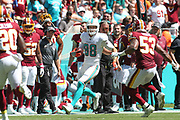Sunday, October 13, 2019; Miami Gardens, FL USA;  Miami Dolphins tight end Mike Gesicki (88) catches a pass and runs for additional yards during an NFL game against Washington  at Hard Rock Stadium. The Redskins beat the Dolphins 17-16. (Kim Hukari/Image of Sport)