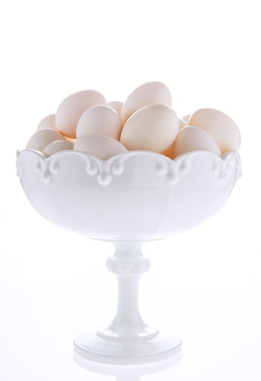 White eggs in a white vintage bowl