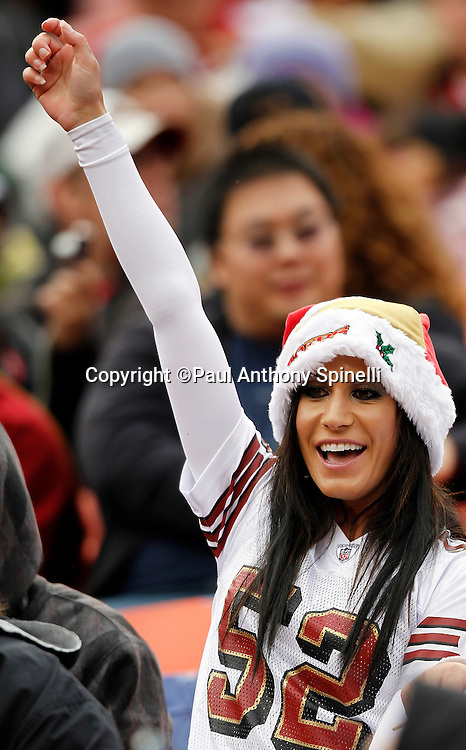 A San Francisco 49ers fan cheers during the NFL week 17 football game against the Arizona Cardinals on Sunday, January 2, 2011 in San Francisco, California. The 49ers won the game 38-7. (©Paul Anthony Spinelli)